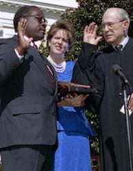 clarence thomas sworn in while wife virginia looks on